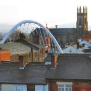 Trinity Church in Bolton, Lancashire. The arch is the new rail bridge over Newport St.