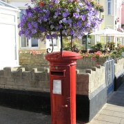 Even the sea front post box gets the floral treatment at Sidmouth, South East Devon.