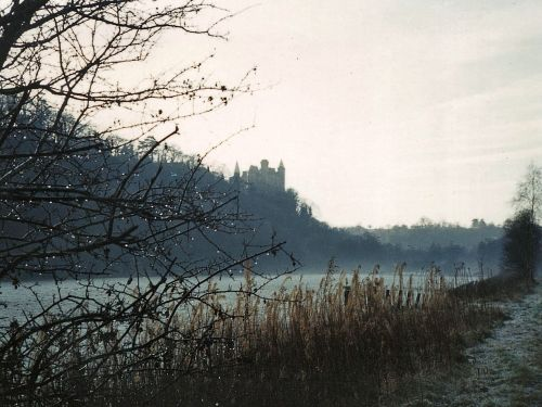Alton Castle, viewed from far bank of river Churnet on a winter morning