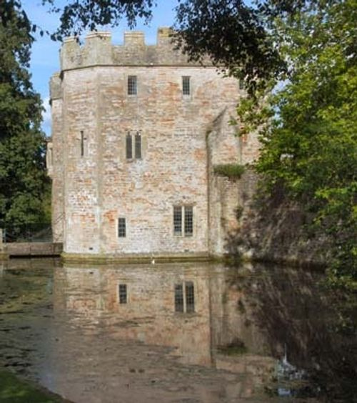 Reflection of the Gatehouse in the moat. The Bishops Palace, Wells.