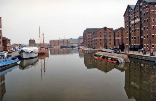 Gloucester Docks. Showing the huge victorian warehouses, and a sunken boat. 1990