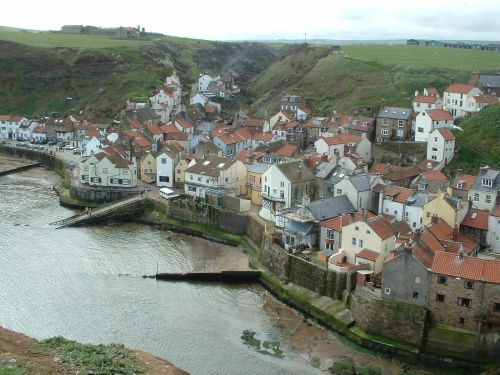 Staithes, North Yorkshire. Looking down accross the harbour from the Cowbar.