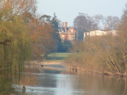 Manor house across the Thames as viewed from Wallingford Bridge.  Wallingford, OXON