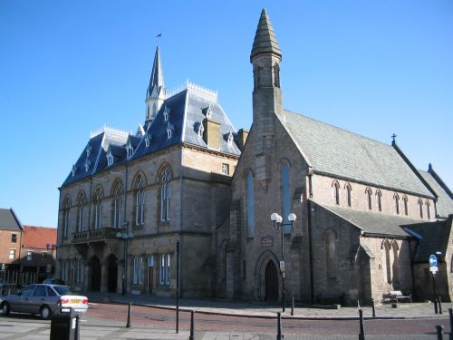 Bishop Auckland market place. Town hall and St Anne's church.