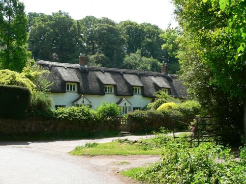 Thatched houses in the village of Holford on the edge of the Quantock hills, Somerset