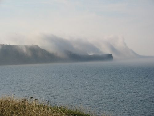 Sea mist rises over Sandsend Ness, Whitby, North yorks