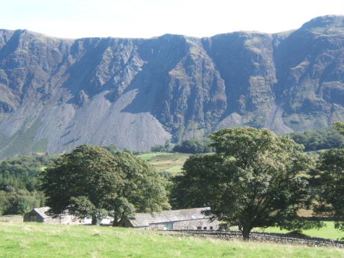 Gentle farmland of lower Wasdale with the dramatic backdrop of the screes.