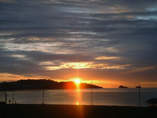 Sunrise over Torquay from Cambria Hotel, Paignton Seafront, Devon.