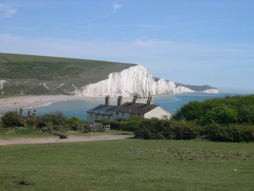 The classic view of the Seven Sisters in East Sussex, with the cottage in the foreground