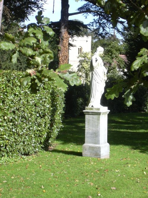 Brodsworth Hall, South Yorkshire. Garden statue and church