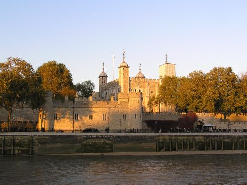 The Tower of London with traitor's gate seen from the river in evening light