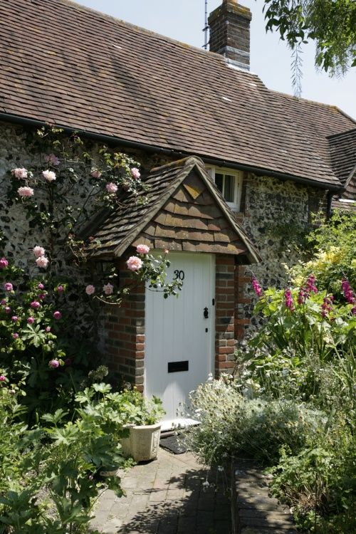 Cottage in village with  flowers
