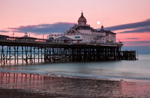 Moon over Eastbourne pier