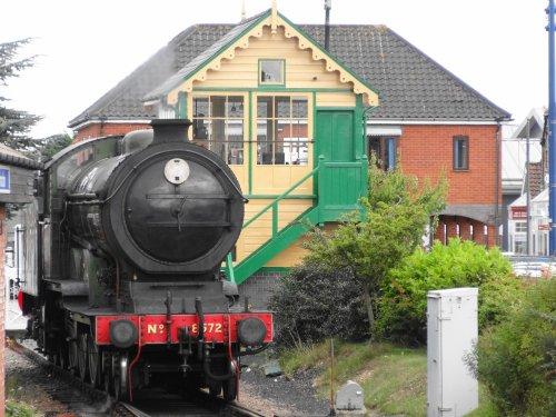Sheringham Station, steam train passing the signal box