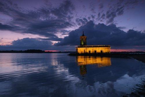 The Normanton Church illuminated at night.