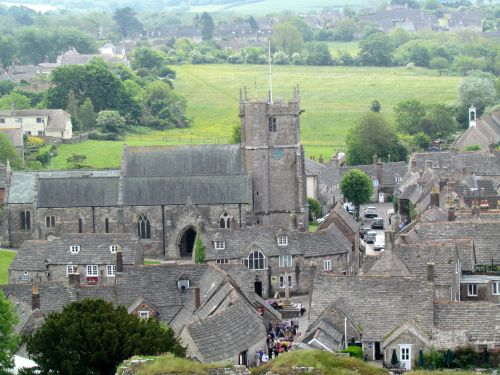 The church, and village of Corfe Castle, in Dorset