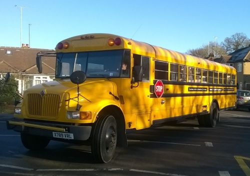 the big yellow bus comes to the school