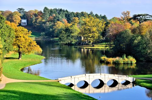 Autumn View of the 5 Arch Bridge & Gothic Temple at Painshill Park in Cobham, Surrey