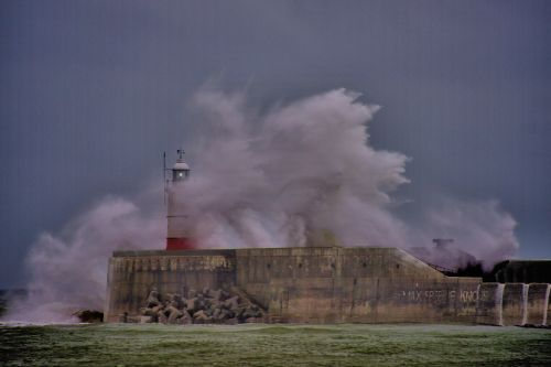 Waves Crashing Over the Lighthouse at Newhaven in Sussex