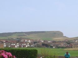 A picture taken walking along a road in Seaford. Beachy Head is in the background.