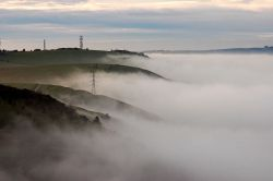 Fog rolls over the South Downs on the Fulking Escarpment, West Sussex