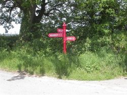An unusual red sign post. Somerset, England