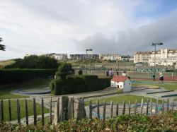 Bude. Tennis courts and crazy golf complete with ornamental hedge in shape of a train.