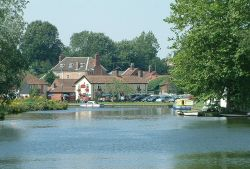 The River Bure at Coltishall, the current head of navigation. In the background the Rising Sun Pub.