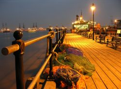 Harwich's historic Ha'penny Pier at night, Looking towards Felixstowe Docks. Essex