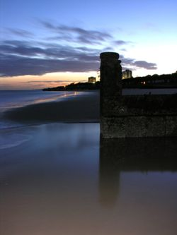 Groyne and Sea at Frinton On Sea at night.