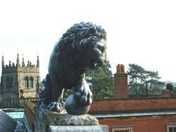 Lion photographed on roof of Staunton harold hall, by richyp. 2002