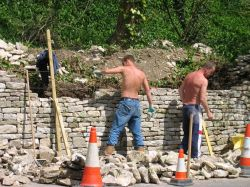 Repairing stone wall, Bisley, Gloucestershire, Cotswolds.