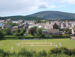 Millom cricket ground, match in progress.