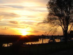 REEDHAM, NORFOLK. SUNSET VIEW IN OCTOBER FROM 'ROSE COTTAGE'