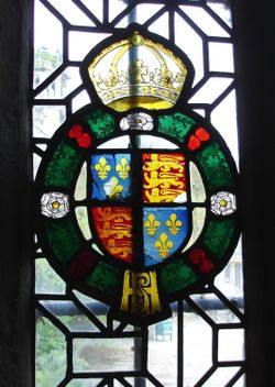 Ancient stained glass showing the royal arms at Haddon Hall, Derbyshire