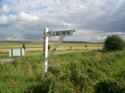 Fingerpost pointing to one of the pubs at Broad Hinton, Wiltshire