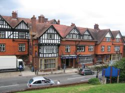 The Crown Hotel which is opposite Saint Michael and All Angels church, in Lyndhurst, Hampshire