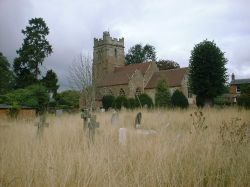 St. Peters Parish Church in Dunchurch Village from the surrounding cemetery looking southwest.