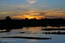 The London Wetland Centre. Sunset over lagoon.