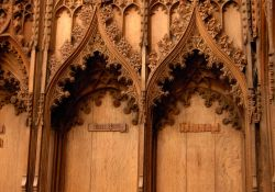 Norwich Cathedral, upper choir stalls with crocketed ogee arch canopies. Norwich, Norfolk.