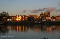 London River Thames, Hammersmith, evening light on the riverside with reflections.