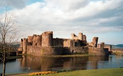 Caerphilly Castle, with daffodils bloomimg in the grounds in the Spring of 2002.