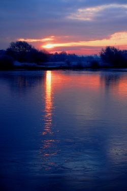 Sunrise over icy lake, Kingsbury Water Park, North Warwickshire.