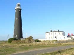 The old lighthouse, Dungeness, Kent, sits comfortably in the very distinctive landscape.