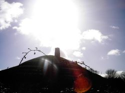 Glastonbury tor with the winter sun above it