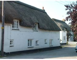 Thatched cottages in the leat. Stratton, Cornwall