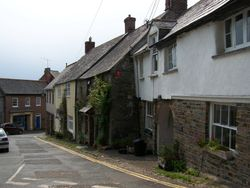 Cottages in Jubilee square, looking down to butcher shop. Stratton, Cornwall