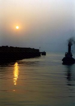 A Steam Tug Approaching Whitstable Harbour at Sunset