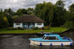 Pleasure boat and house near the Broad