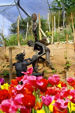 Bronze statues and flowers.